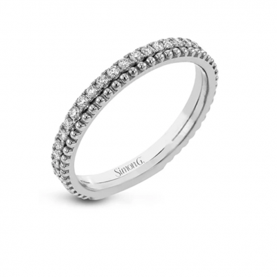 A line of .33 ctw of white diamonds sits alongside a row of granulation in this band that adds the ideal touch of shine. perfect for stacking with other rings.